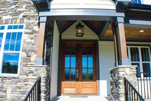 Wooden front door with glass windows