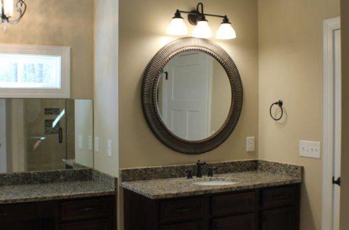 circular mirror in a bathroom