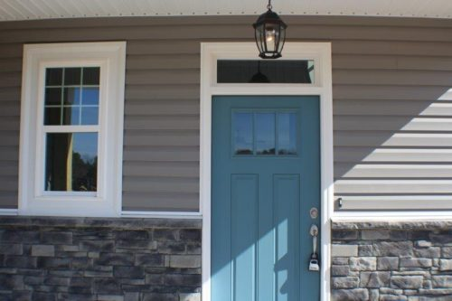 a teal front door with a padlock