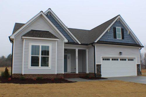 Winslow Homes custom light blue and blue house