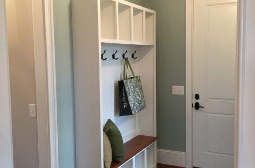 Winslow Homes custom coat hangers in a cabinet