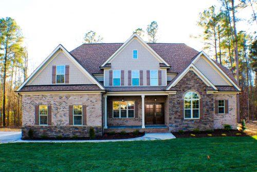 Winslow Homes custom reddish, brown house
