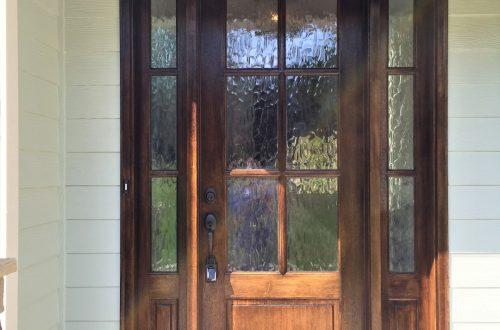front wooden door with glass